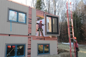 Doors are pre-installed in 'mini-panels', which are dropped in place on site.