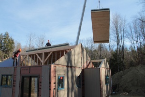 Roof panels are flown by crane, just like the walls.